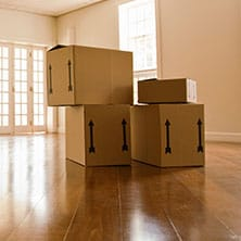 moving boxes on an empty living room floor
